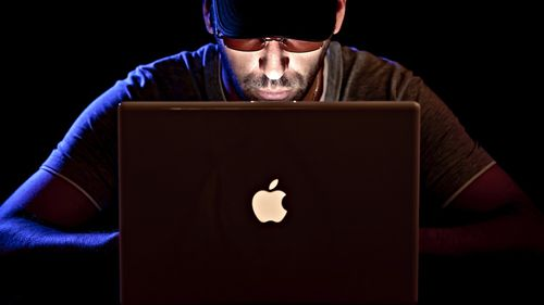 Hacker (Cropped, original by Christophe Verdier licensed CC-BY-NC)
